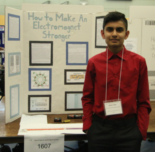 A photo of me at REgional Science Fair in grade 8.
