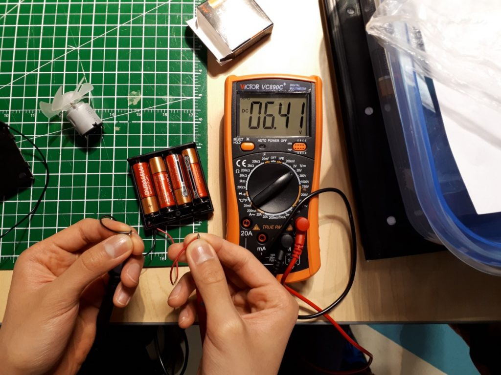 Text Box: Figure 5. Four AA batteries measured to have a total voltage of 6.41V