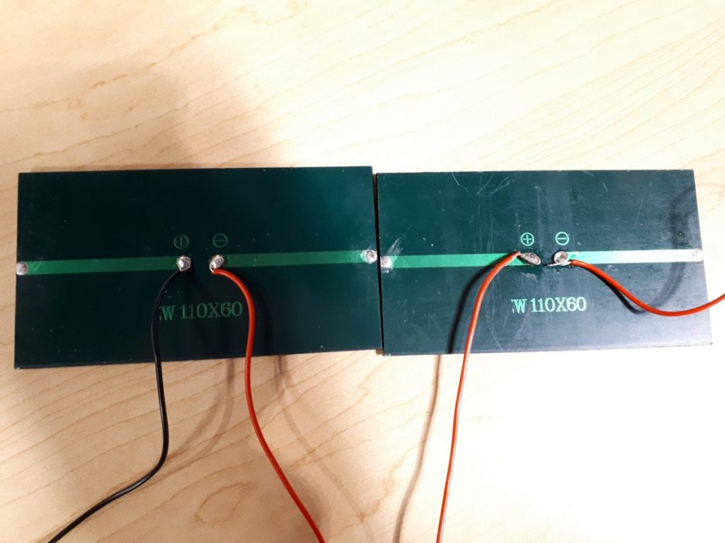 Text Box: Figure 6. The solar panels were connected in this way and were functioning properly as the multimeter produced a voltage reading when both wires were placed on the probes.