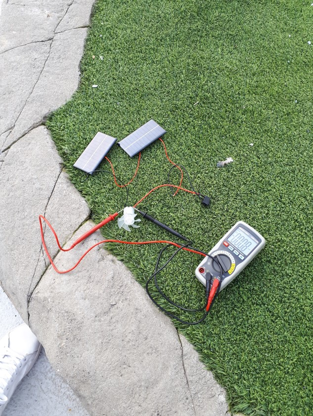 Text Box: Figure 8. Testing setup of the solar-powered fan Figure 9. The voltage measurements of the solar-powered fan were taken under these light conditions.